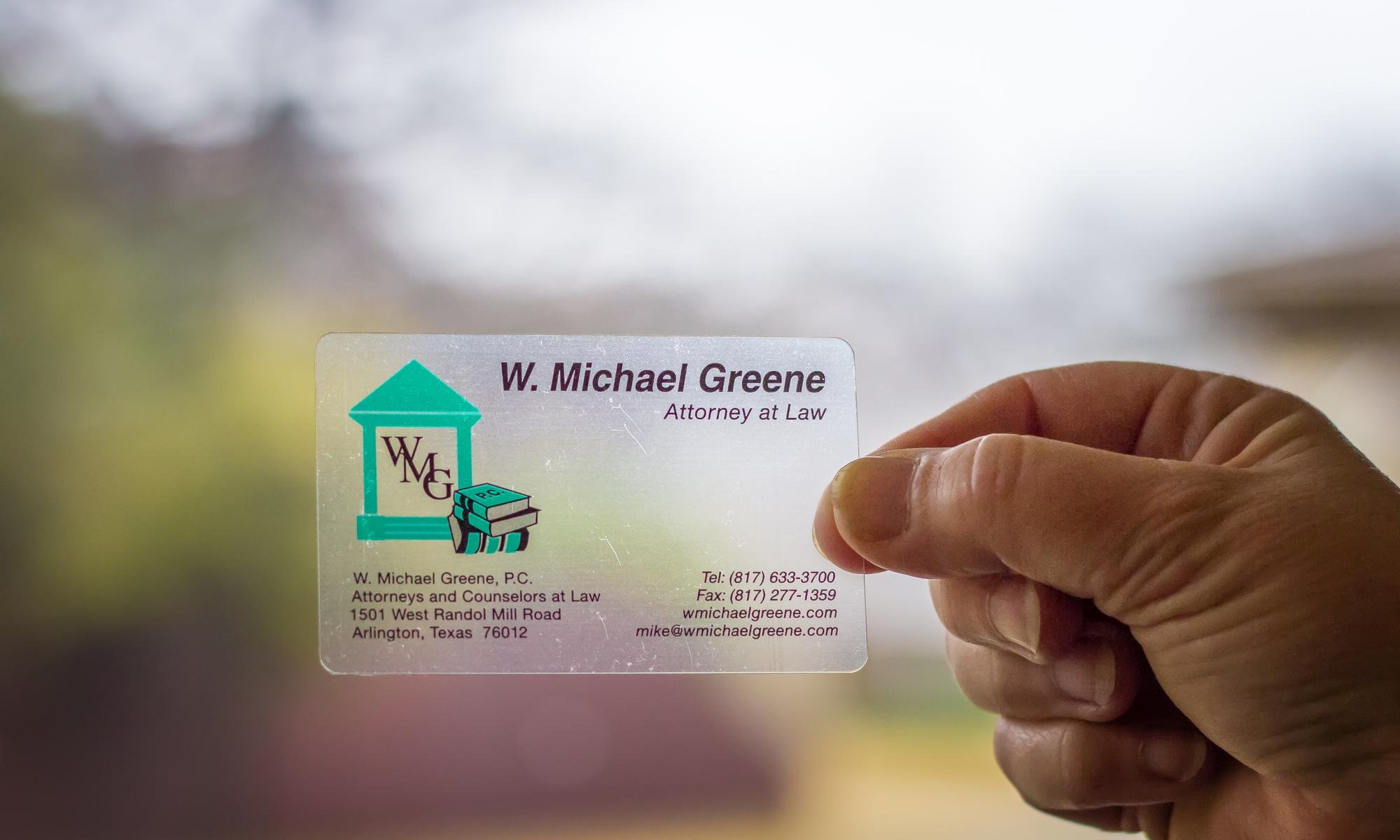 W Michael Greene's business card held up to the light